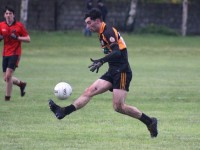 Austin Stacks David O'Sullivan on the attack. Photo by Dermot Crean
