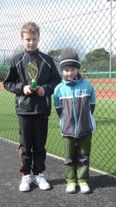 Mark Gazi with his brother Danny after winning the U10's 2016 Carrialine Junior Tennis Open
