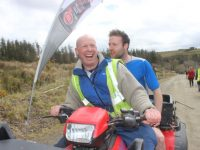 Head Steward Kevin Leen gives a lift to Aidan Breen who lost his shoes on the course at the Lee Strand-sponsored 'BWildered' event on Saturday. Photo by Dermot Crean