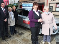 Mary Jeffers from Ardfert being handed the keys to a new Nessan Pulser by Helen Geary of Tralee Credit Union. Back Row, David Randles (Randles Brothers Garage), Eileen Kirwin and Mary McElligott. Photo by Gavin O'Connor.