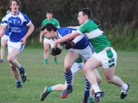 David Moran is tackled by Legions Shaun Keane. Photo by Gavin O'Connor.