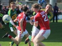 Ruairi Deane hits Kieran Donaghy high. Photo by Dermot Crean.