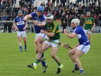 Jack Goulding comes under pressure from Darren Maher of Laois. Photo by Gavin O'Connor.
