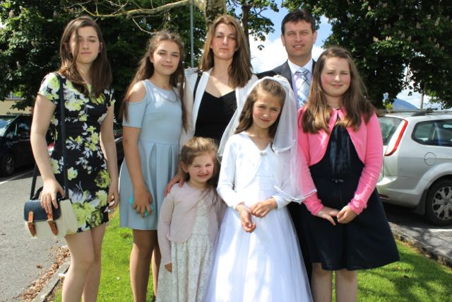 Caherleaheen NS pupil, Keelin Flannery, who made her First Holy Communion at the Church of the Immaculate Conception in Rathass, joined by her family, Kelly, Christina, Casey, Julie, Chris and Kim. Photo by Dermot Crean