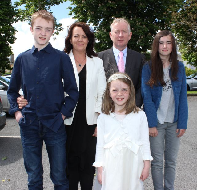 Caherleaheen NS pupil, Rachel Moynihan, who made her First Holy Communion at the Church of the Immaculate Conception in Rathass, joined by her family, Jack, Ita, John and Katie. Photo by Dermot Crean