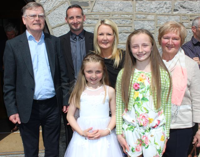 Caherleaheen NS pupil, Aoife Ross, who made her First Holy Communion at the Church of the Immaculate Conception in Rathass, joined by grandad John O'Shea, parents Mike and Carmel, sister Katie and grandmother, Paula O'Shea. Photo by Dermot Crean