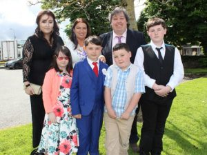 Caherleaheen NS pupil, Conor Crean, who made his First Holy Communion at the Church of the Immaculate Conception in Rathass, joined by family, Jade, Ruby, Carol, Alan, Aaron and Ryan. Photo by Dermot Crean