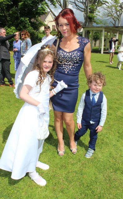 Caherleaheen NS pupil, Natasha Egan, who made her First Holy Communion at the Church of the Immaculate Conception in Rathass, joined by her family, Vicky and Ryan. Photo by Dermot Crean