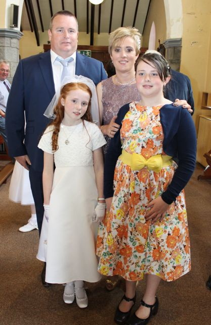 Caherleaheen NS pupil, Roisín Sugrue, who made her First Holy Communion at the Church of the Immaculate Conception in Rathass, joined by her family, Ian, Susan and Ciara. Photo by Dermot Crean
