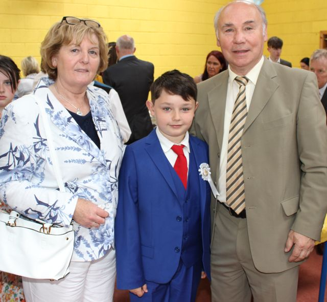 Caherleaheen NS pupil, Conor Crean, who made her First Holy Communion at the Church of the Immaculate Conception in Rathass, with grandparents Marie and Jerry Crean. Photo by Dermot Crean