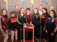 Alanna Whelan, Caoimhe Diggin, Patrice Spillane, Teresa O'Connor, Sarah Murphy, Clodagh Walsh, Emma Lawlor. At back, John Leen and John Horgan, at the drawing of the Kerry Camogie Golden Ticket in the Rose Hotel on Wednesday night. Photo by Dermot Crean