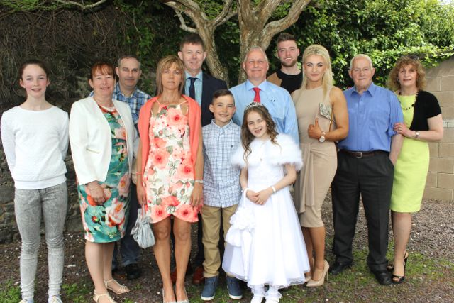 CBS pupil Isabel Clifford who made her first Holy Communion in St John's Church on Saturday morning with Oriana Garvey, Helen Locke, Ciaran Clifford, Liz Locke, Junior Locke, Rory Clifford, Anthony Clifford, Craig Locke, Helen O'Rourke, Martin Clifford and Breda Garvey. Photo by Dermot Crean