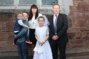 CBS pupil Emma Callaghan who made her first Holy Communion in St John's Church on Saturday morning with Adam, Cian, Karen and Dave Callaghan. Photo by Dermot Crean