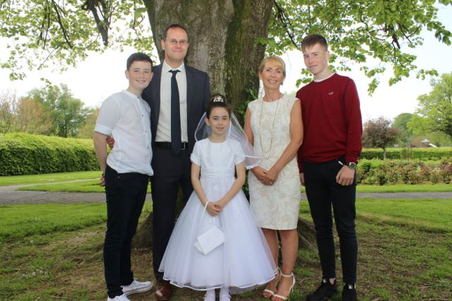 CBS pupil Amy Scanlon who made her first Holy Communion in St John's Church on Saturday morning with parent Dave and Lorraine and brothers Greg and Dean. Photo by Dermot Crean
