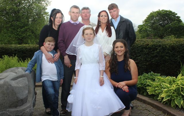 CBS pupil Chantelle O'Brien who made her first Holy Communion in St John's Church on Saturday morning with Philip O'Brien, Sisa O'Brien, Earl Leahy, John O'Brien, Geraldine Leahy, Philip O'Brien and Christine Leahy. Photo by Dermot Crean