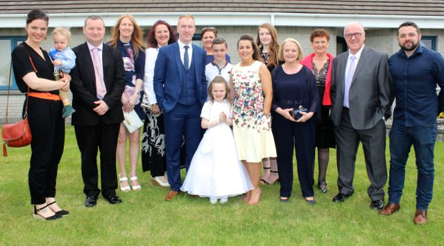 Listellick pupil Chloe O'Sullivan who made her first Holy Communion in Our Lady and St Brendan's Church on Saturday morning with Amelia Quenson holding Matisse, Joby and Denise Costello, Tania, Timmy, Majella, Conor, Grainne O'Sullivan, Rachel Costello, Noreen Power, Sheila O'Sullivan, Denis O'Sullivan and Sean Power. Photo by Dermot Crean