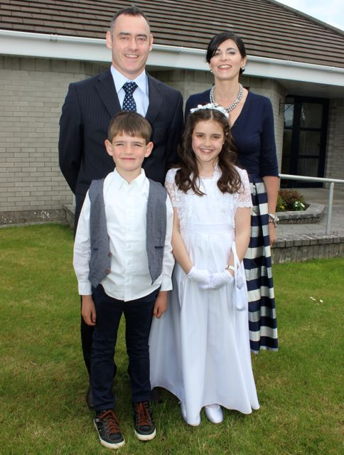 Listellick pupil Ciara Laide who made her first Holy Communion in Our Lady and St Brendan's Church on Saturday morning with Pa, Louise and Barry Laide. with Photo by Dermot Crean