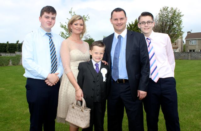 Listellick pupil Jerry Lynch who made his first Holy Communion in Our Lady and St Brendan's Church on Saturday morning, with Evan, Miriam, Jerry and Cian Lynch. Photo by Dermot Crean