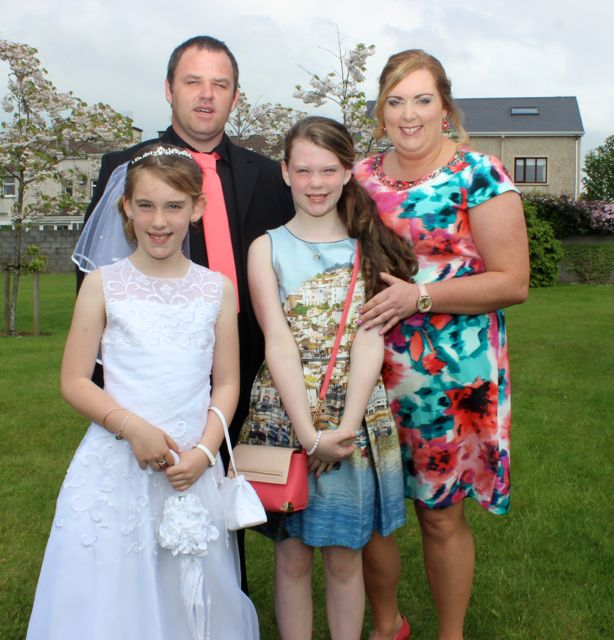Listellick pupil Kayleigh Enright who made her first Holy Communion in Our Lady and St Brendan's Church on Saturday morning with Valerie, Tim and Sheila Enright. Photo by Dermot Crean