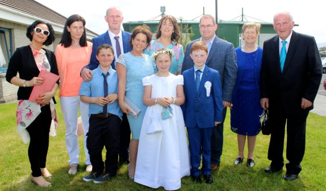 Listellick pupils and cousins Meabh Dwyer and Conor Flaherty who made their first Holy Communions in Our Lady and St Brendan's Church on Saturday morning with, Rachel Brosnan, Irene Dwyer, Brendan Dwyer, Declan Dwyer, Sinead Dwyer, Frances Flaherty, Paddy Flaherty, Rosarie and Frank Dwyer. Photo by Dermot Crean