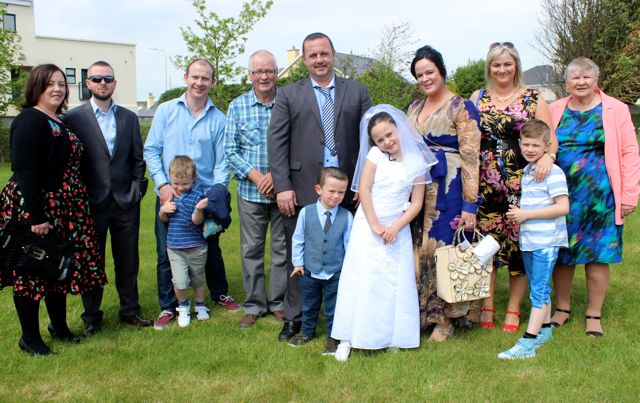 Listellick pupil Megan O'Brien who made her first Holy Communion in Our Lady and St Brendan's Church on Saturday morning with Jessica Gleesom, Michael Cahill, Daniel Breen, Johnny Breen, Michael Cahill, Alan O'Brien, Jamie O'Brien, Olivia O'Brien, Lisa Breen, John Breen and Eileen Cahill. Photo by Dermot Crean