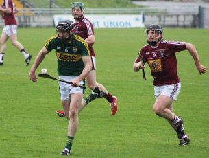 Kerry's Darren Dineen comes away with the ball. Photo by Gavin O'Connor.