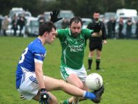 Jack Savage sells a dummy to Damian Murphy during the Kerins O'Rahillys v Milltown/Castlemaine match on Sunday. Photo by Dermot Crean