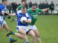 Damian Murphy tackles David McLaughlin during the Kerins O'Rahillys v Milltown/Castlemaine match on Sunday. Photo by Dermot Crean