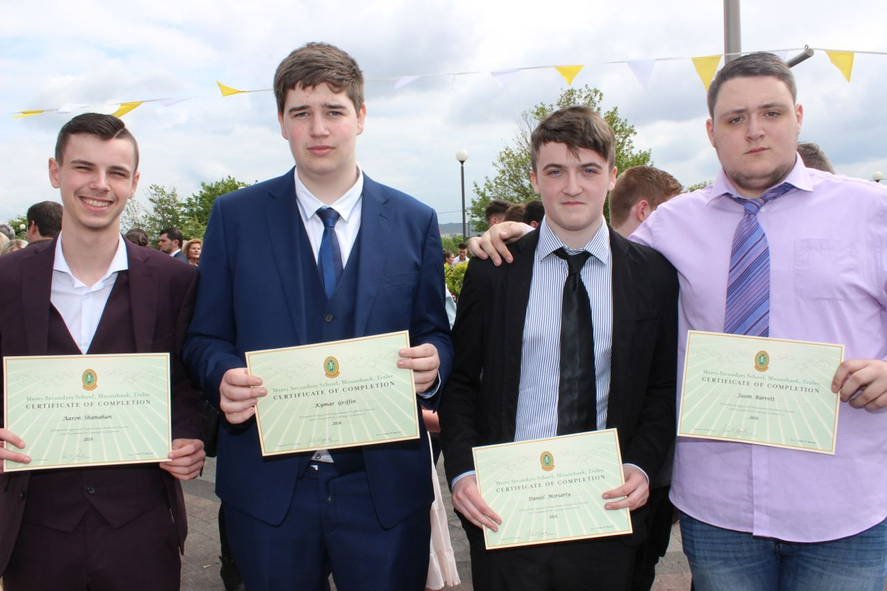 Aaron Shanahan, Kyman Griffin, Daniel Moriarty and Jason Barrett at the Mercy Mounthawk graduation ceremony at Our Lady and St Brendan's Church on Friday afternoon. Photo by Dermot Crean