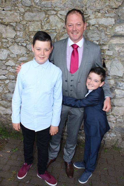 Alan Wall, Alan Griffin and Reuben Wall at the Moyderwell Primary School First Holy Communion Day at St John's Church on Saturday morning. Photo by Dermot Crean