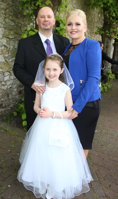 Kevin and Jacinta O'Connor with daughter Rachel at the Moyderwell Primary School First Holy Communion Day at St John's Church on Saturday morning. Photo by Dermot Crean