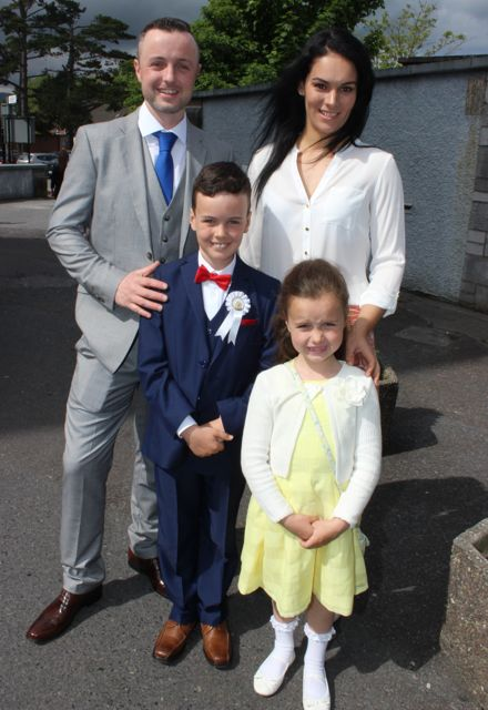 Tadhg Healy and Sarah O'Connell with Blake O'Connell Healy and Nicole O'Connell Healy at the Moyderwell Primary School First Holy Communion Day at St John's Church on Saturday morning. Photo by Dermot Crean
