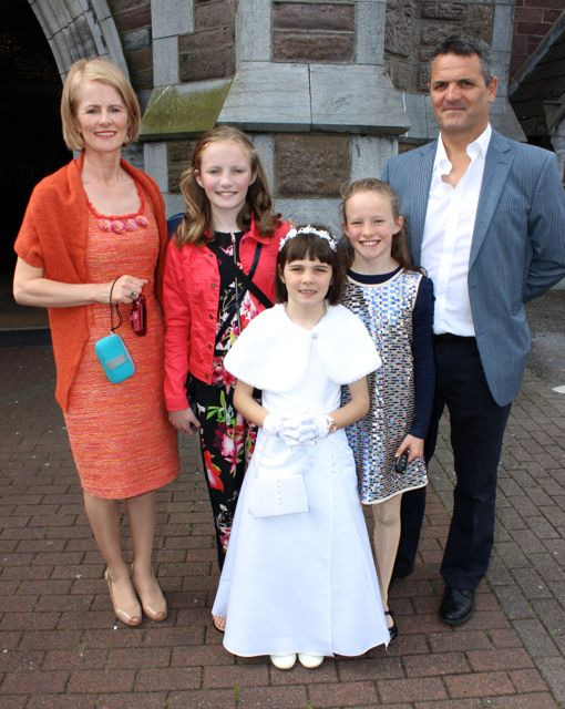 Communion girl Saoirse O'Connor McCarthy with Patricia O'Connor, Cliodhna O'Connor McCarthy, Aoibhín O'Connor McCarthy and Colm McCarthy at the Moyderwell Primary School First Holy Communion Day at St John's Church on Saturday morning. Photo by Dermot Crean