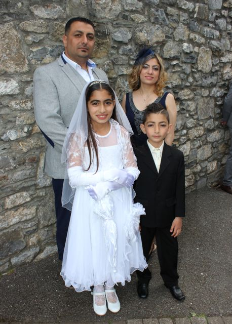 Communion girl Hala Khudur with Rami, Elias and Shaza Khudur at the Moyderwell Primary School First Holy Communion Day at St John's Church on Saturday morning. Photo by Dermot Crean