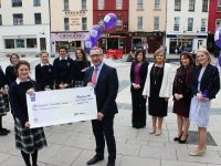 At the cheque handover of €3000 from AIB bank to Presentation Secondary School were in front, Sarah Fitzgerald and AIB Tralee Branch Manager, Joe Shannon. Back: Eimer Brosnan, Kate O'Connor, Muireann Moriarty, Isabelle Horgan, Maeve Dowling, Sarah Leahy, Noreen O'Grady, Lilianne O'Connor and Mary Rose Cantillon. Photo by Gavin O'Connor.