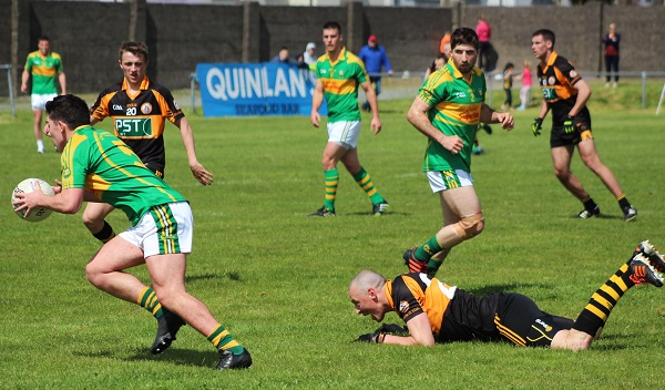 South Kerry, Conor O'Shea turns outside Kieran Donaghy who lost his footing. Photo by Gavin O'Connor.