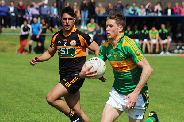 Austin Stacks, Wayne Guthrie chases down South Kerry's Aidan Walsh. Photo by Gavin O'Connor.