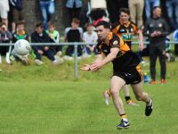 Pa McCarthy lays off a pass. Photo by Gavin O'Connor.