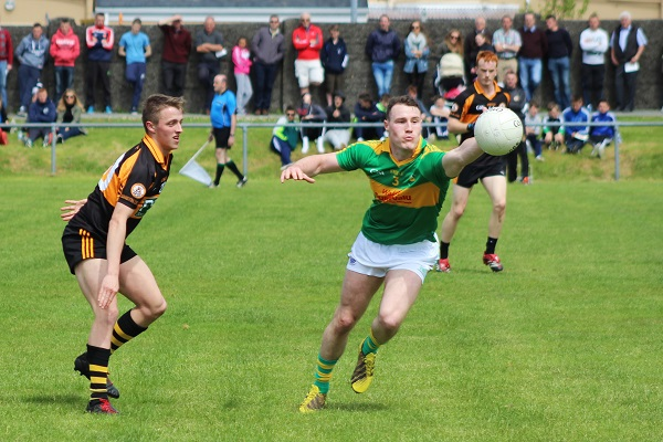 South Kerry's Mark Griffin gets ahead Sean Ryan. Photo by Gavin O'Connor.