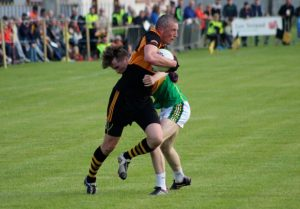 Kieran Donaghy tries to pass Rob Wharton during the Austin Stacks v South Kerry game on Saturday. Photo by Dermot Crean