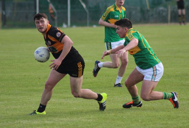 Conor Jordan looks for a man to pass to while Conor O'Shea gives chase during the Austin Stacks v South Kerry game on Saturday. Photo by Dermot Crean