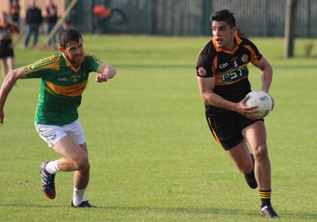 Greg Gibson gives chase to Wayne Guthrie during the Austin Stacks v South Kerry game on Saturday. Photo by Dermot Crean