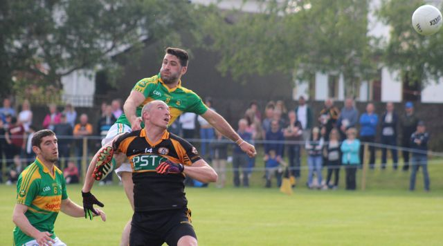 Kieran Donaghy keeps his eye on the ball with fellow inter-county men, Killian Young and Bryan Sheehan close at hand during the Austin Stacks v South Kerry game on Saturday. Photo by Dermot Crean