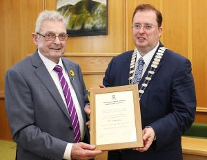Ted Moynihan receiving a citation to mark his civic reception from Mayor of Tralee, Cllr Tom McEllistrim. Photo by Gavin O'Connor.