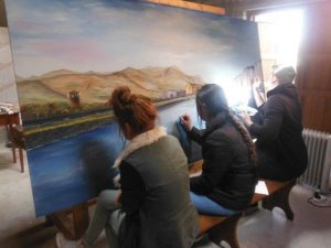 Tralee Art Group members and KDYS students working on a mural for Baile Mhuire Day Care Centre.