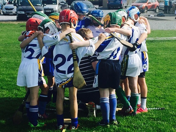 An underage Tralee Parnells team get some last minute instruction before they take the field.