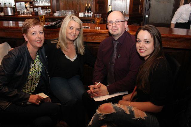 Aislinn Ní Mhanach, Kerry O'Mahony, Kevin O'Connor and Yana Sokolova at the table quiz in The Ashe Hotel on Thursday night. Photo by Dermot Crean
