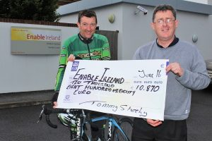 Tommy Sheehy hands over a cheque of €10,870 to Sean Scally of Enable Ireland. Photo by Gavin O'Connor.