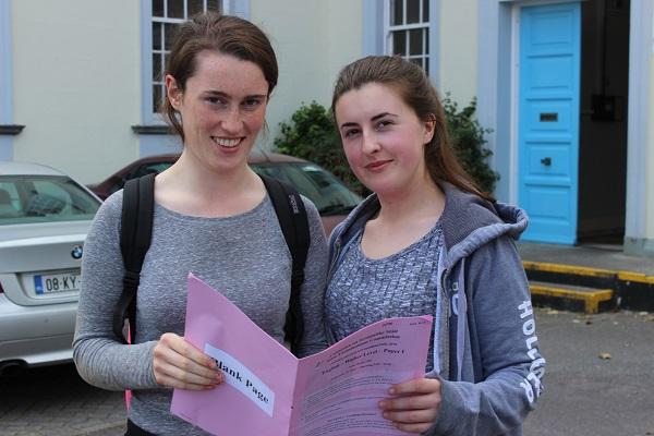 Gaelcholaiste Chiarrai students Aoife Ní Bheacháin and Anna Ní Mháinséal sitting the first of their Leaving Cert exams. Photo by Gavin O'Connor.