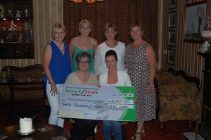 Keel GAA, Club Secretary Laura O'Shea pictured presenting a cheque to Breda Dyland (Manager KCSG) in Murphy's Bar in Keel, Sunday 5th June. Backrow: Mary Ashe, Mary-Theresa Murphy, Jackie Nagle, Betty Sayers.